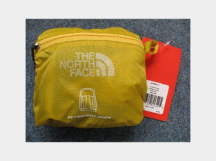 THE NORTH FACE FLYWEIGHT PACK YELLOW